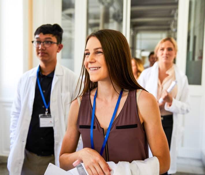 An Atlantis student smiling while walking through the hospital.