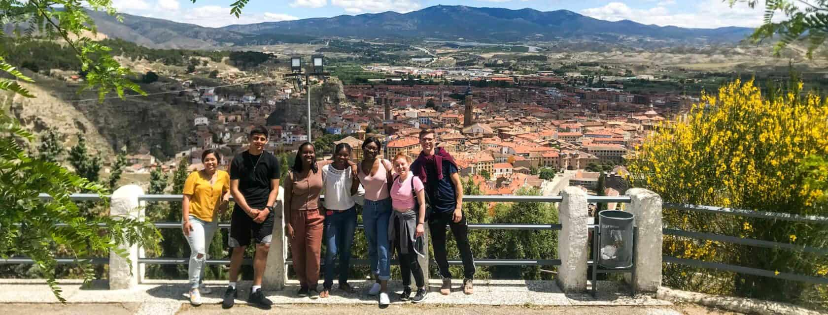 Students standing at a lookout over the city of Calatayud.