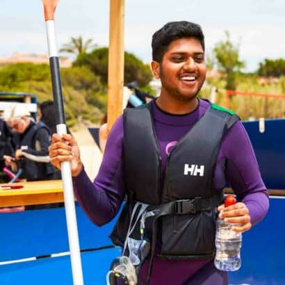 A student getting ready to kayak.