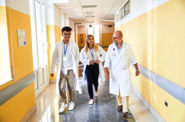 Students walking through a hospital hallway.