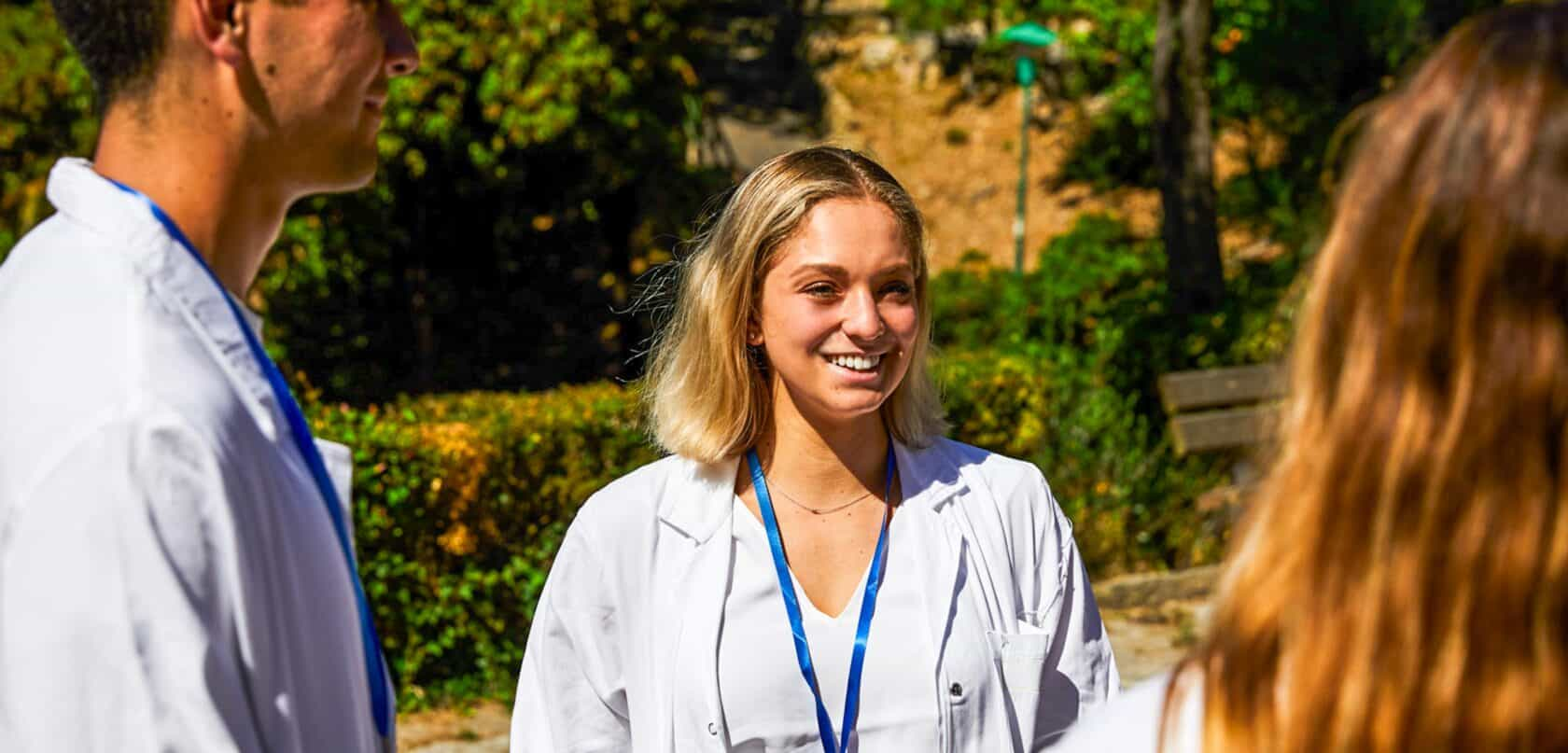 An Atlantis student smiling outside of the hospital.