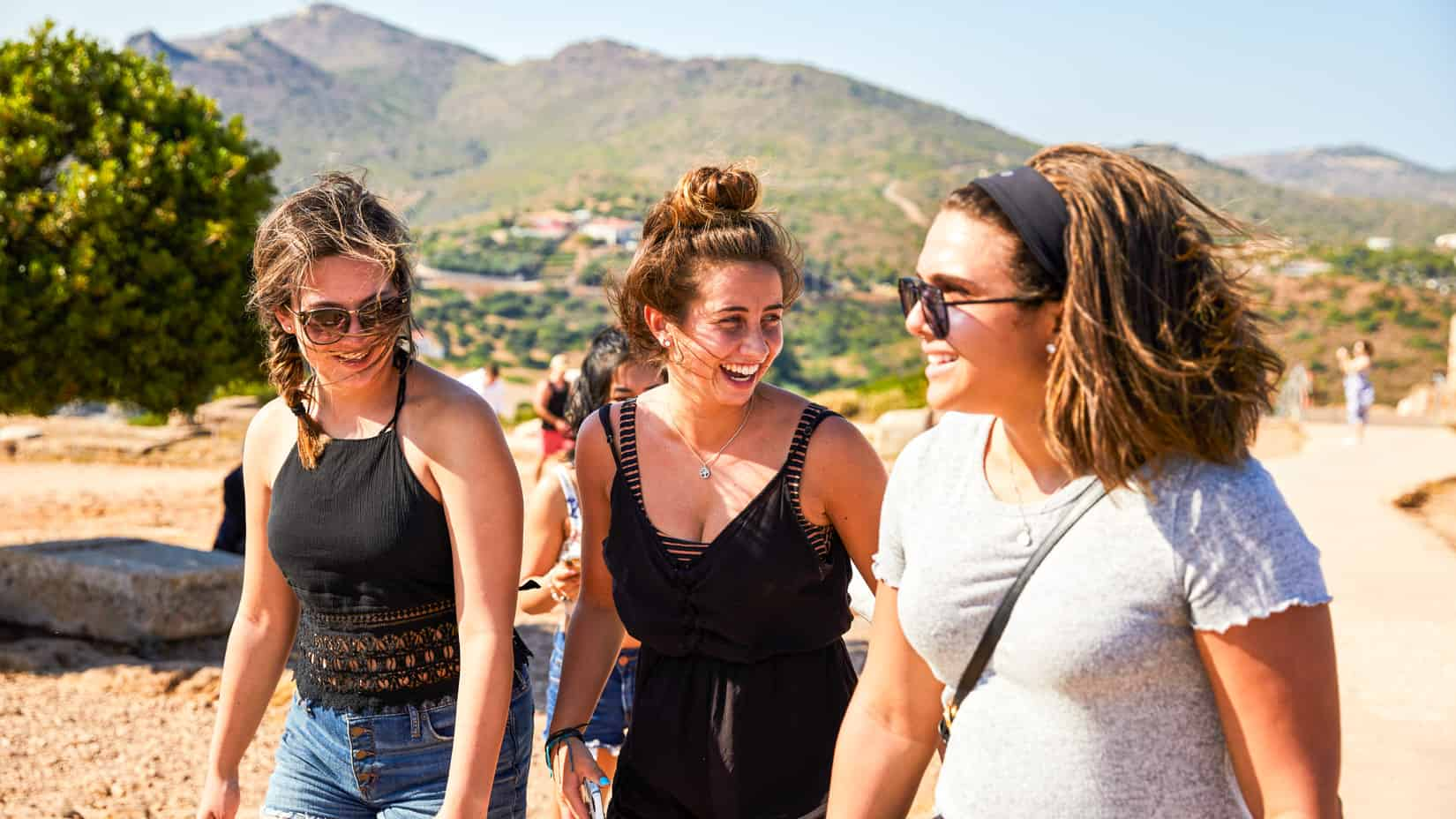 Students walking and smiling on an excursion.