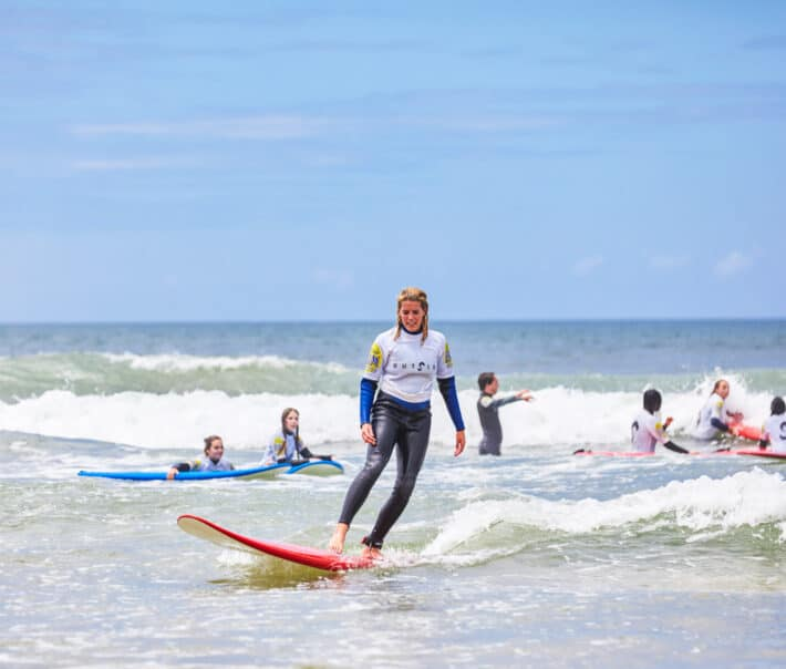 A student learning how to surf.
