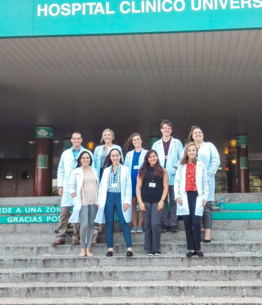 Students in front of the hospital where they are shadowing.