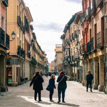 Students walking down a city street.