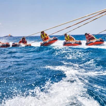 Students tubing in the ocean in Greece.